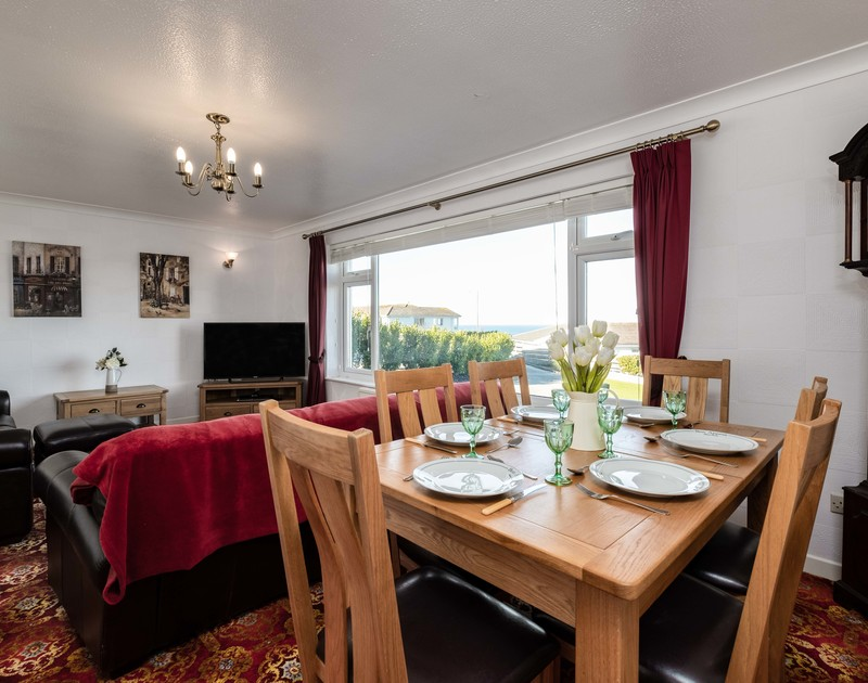 Guests can dine in with sea views at self catering, holiday house Hillview located at Higher Tristram overlooking Polzeath in North Cornwall.