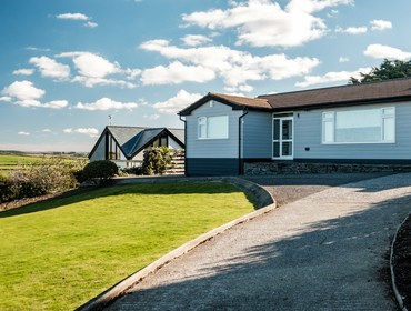 The driveway, front garden and entrance to Hillview a self catering holiday home at Higher Tristram overlooking Polzeath beach and out towards Pentire Head.