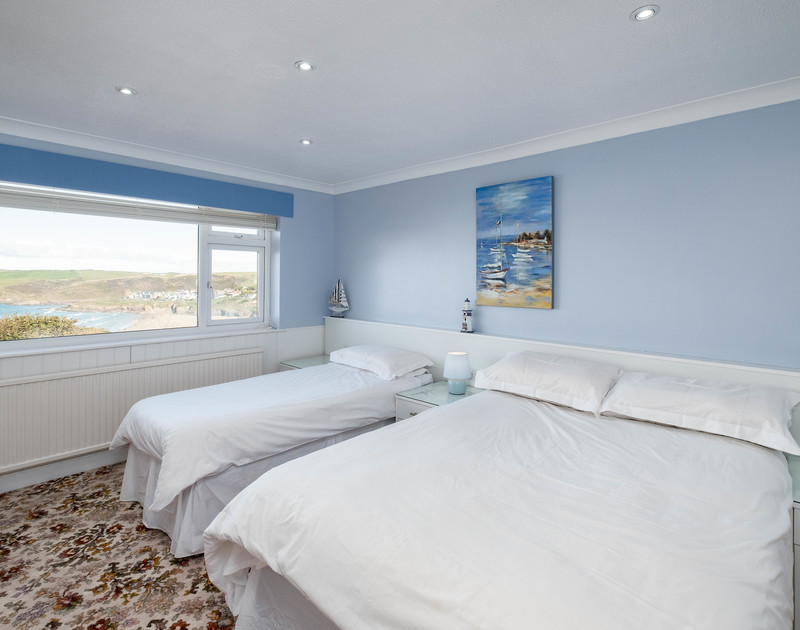A flexible family bedroom with a double bed and a single bed if required at self catering holiday house Hillview in Polzeath.