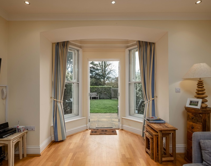 Taken from the sitting room of Lowenna Manor 7, the beautiful bay window and doorway out to the garden in Rock.