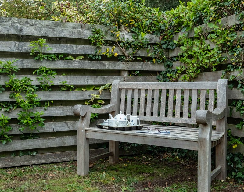 A sheltered spot for afternoon tea in the enclosed garden at Lowenna Manor 7, a self catering holiday house to rent in Rock, Cornwall.