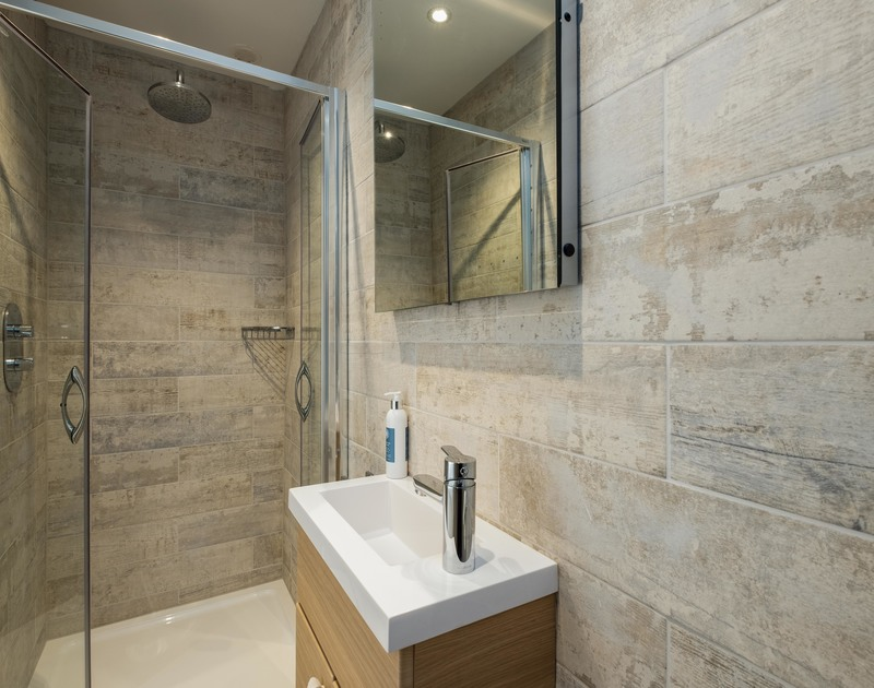 Contemporary, fully tiled  shower room at self catering, holiday house, Lowenna Manor 7, in Rock, Cornwall.