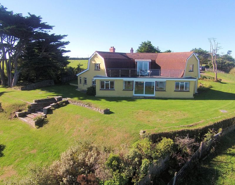 Self catering family holiday property Trevan House set in its own gardens beside the footpath to stunning Lundy Bay on the North Cornish Coast.