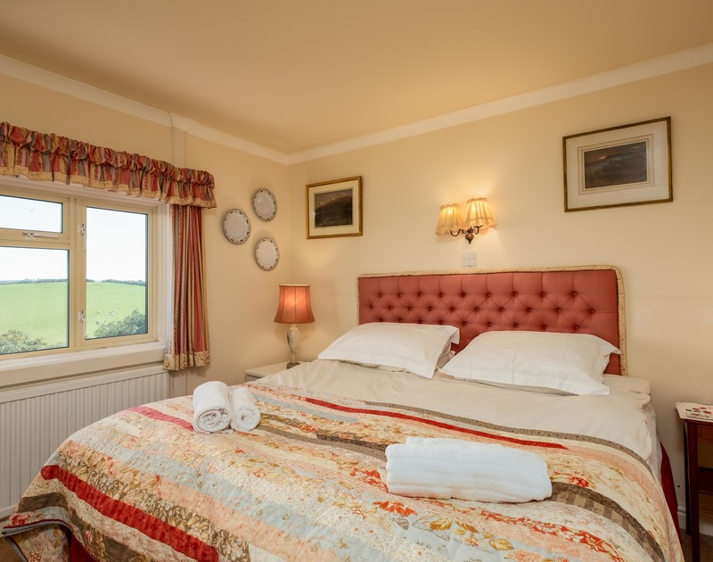 The master double bedroom at traditional self catering holiday rental Trevan House set above Lundy Bay near Polzeath in North Cornwall.