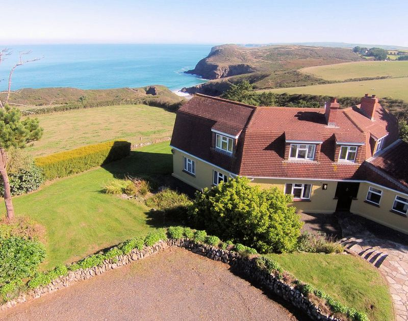 The enviable location and external view of Trevan House set just beside the footpath down to the stunning tidal beach at Lundy bay on the North Cornish Coast.