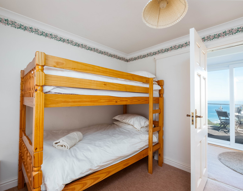 The bunk bedroom at traditional,self catering holiday property Trevan House, a family getaway beside the sea above Lundy Bay and close to Polzeath.