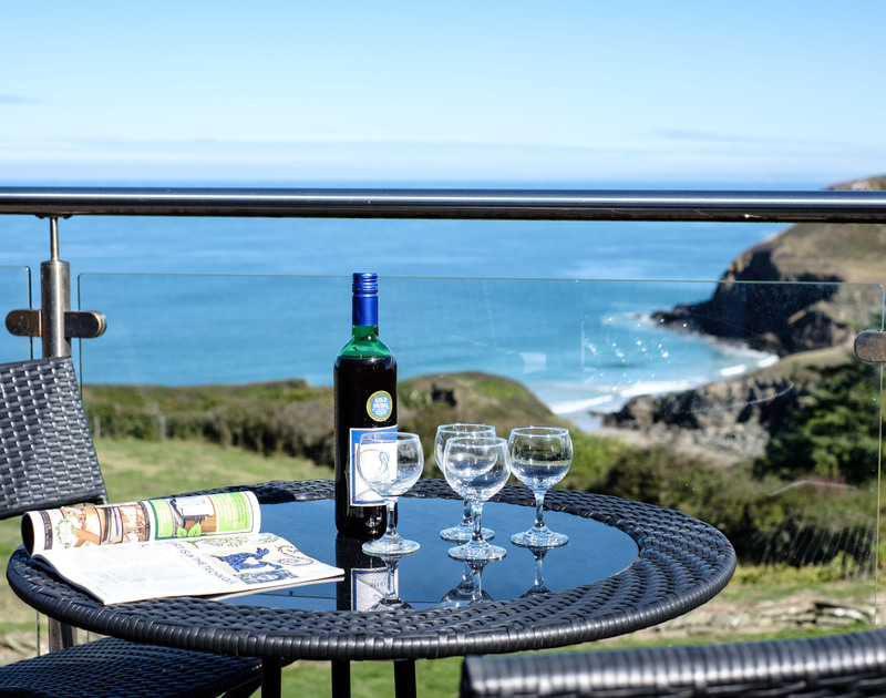 Enjoy a front seat view of the North Cornish Coastline with evening drinks on the balcony at Trevan House, a self catering holiday property just above Lundy Bay.