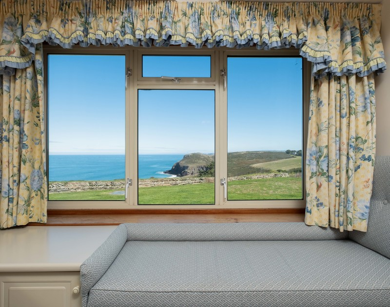 Appreciate the ever changing beautiful and rugged coastline from the window seat at Trevan House, a self catering family holiday property to rent beside the footpath to Lundy bay in North Cornwall.