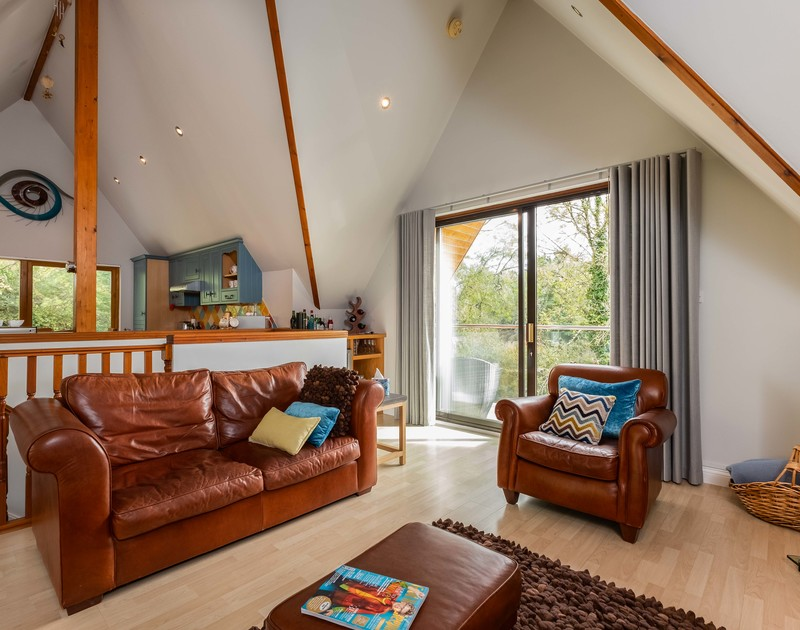 Open plan living at self catering, holiday retreat Alpine Lodge near Rock in Cornwall.