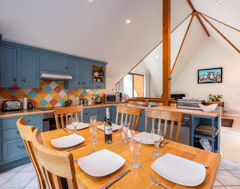 Prepare family meals in the colourful kitchen and dining room at Alpine Lodge.