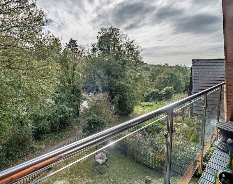 Elevated rural views from the glass balcony at self catering, holiday property Alpine Lodge in a peaceful setting near the Camel Estuary.