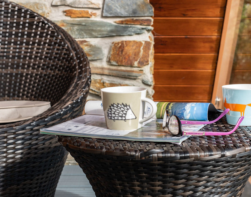 Read a magazine with a cuppa outside in the fresh Cornish air at Alpine Lodge.