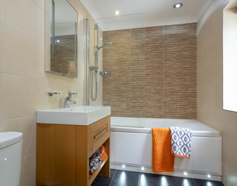 The master bedroom at Alpine lodge has an bright, contemporary ensuite bathroom with overhead shower.