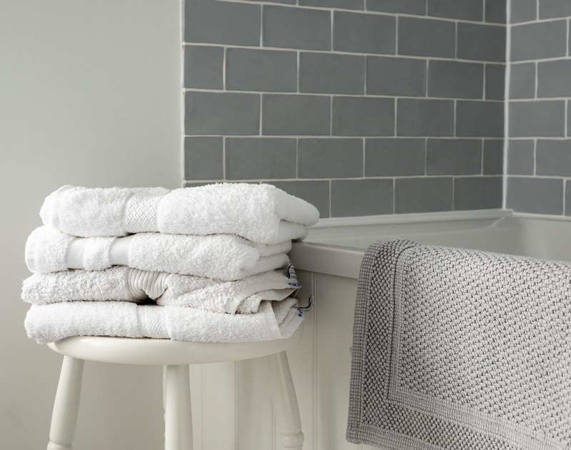 Relax in the newly tiled, modern bathroom with a cool white and grey theme at Mobray, self catering holiday accommodation in Port Isaac.