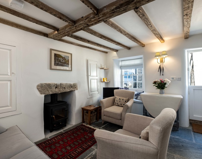 Fabulous large slate slabs on the floor of the beautifully furnished cosy sitting room at Mobray with original features throughout in this elegant Cornish holiday cottage in Port Isaac.