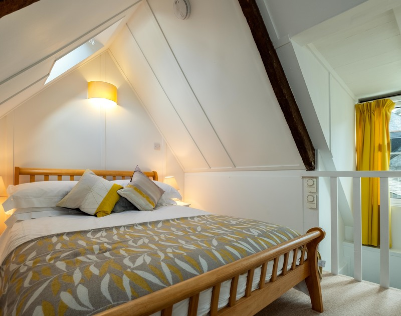 The master bedroom on the top floor at Mobray, a self catering holiday cottage in Port Isaac, is softly carpeted with a king size bed.