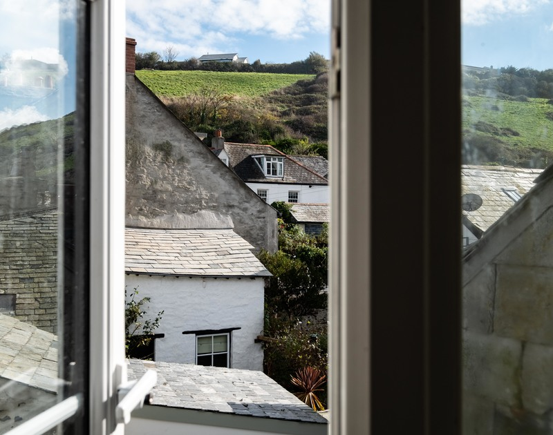 View's over Port Isaac's village from the master bedroom on the top floor at Mobray, a self catering holiday cottage to rent on the North Coast of Cornwall.