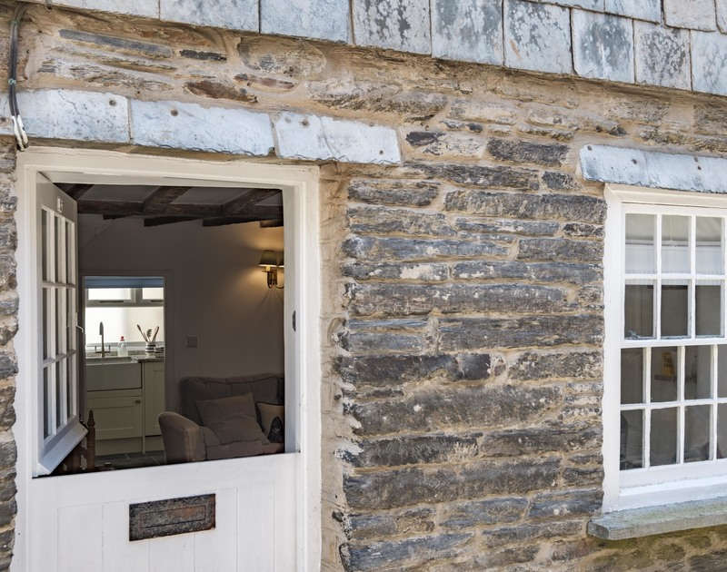 The stable door entrance into recently renovated and elegantly furnished self catering holiday cottage Mobray full of gorgeous original features and yards from the harbour in Port Isaac.