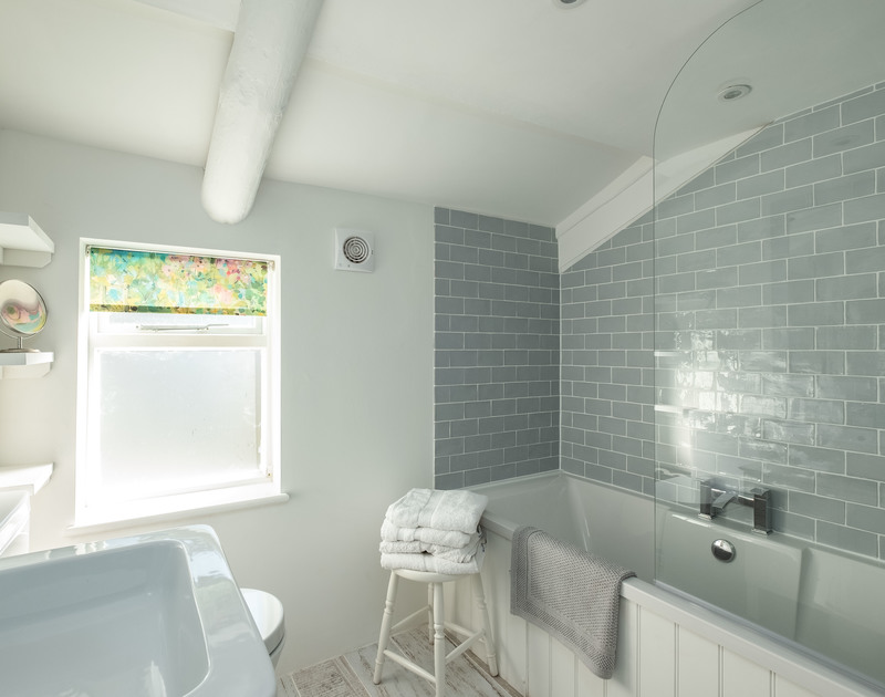 The beautifully stylish and contemporary family bathroom on the first floor at Mobray, a self catering holiday cottage to rent in Port Isaac in North Cornwall.