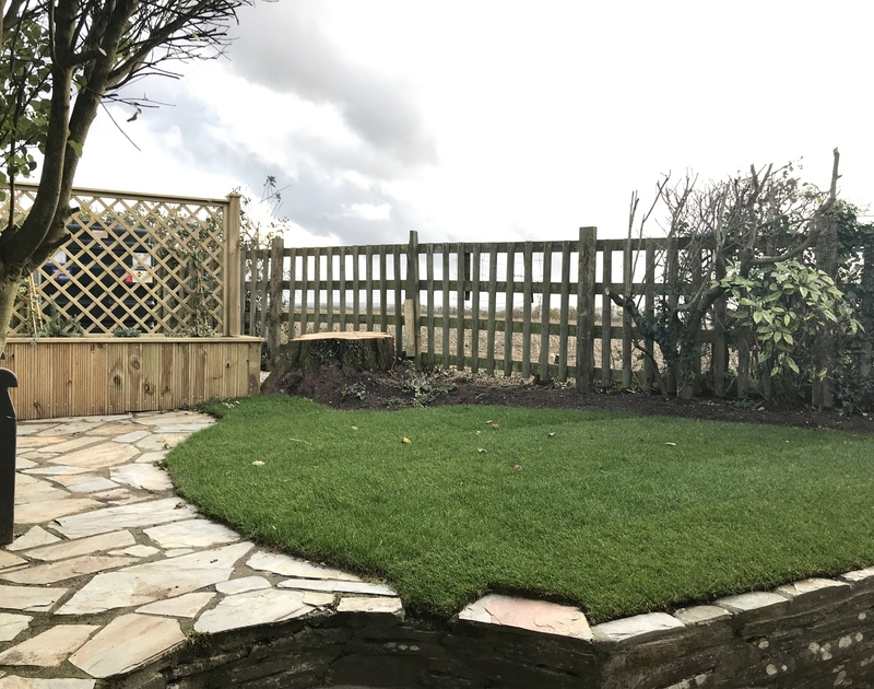 The enclosed garden with a raised, paved terrace area at Little Pityme, a very attractive, detached barn conversion to holiday rent in Rock.