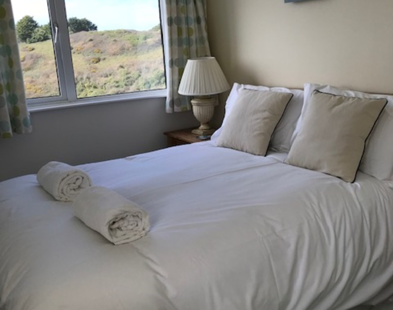 The double bedroom with a sea view at Westpoint, a self catering holiday home in Polzeath, North Cornwall.
