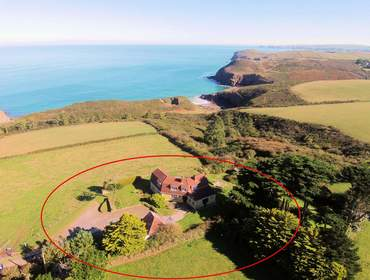 The idyllic setting of Trevan House, a self catering holiday property above Lundy Bay with unsurpassable sea and coastal views.