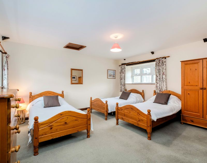 Three single bedrooms with ample space for a cot in The Granary, family holiday accommodation in Rock, North Cornwall.