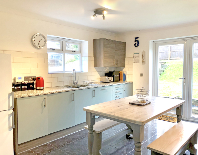 French doors lead out from the newly installed kitchen into the enclosed garden at Silvershell, a holiday cottage to rent in Port Isaac, Conwall