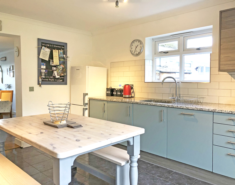 The open plan kitchen at Silvershell, a cottage to rent in Port Isaac, is spacious and ideal for busy family life