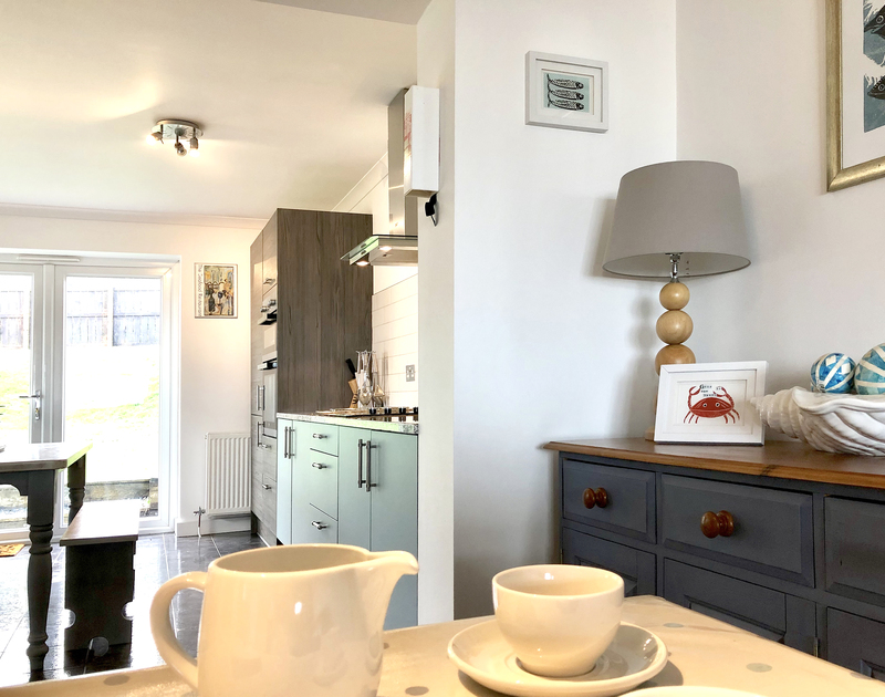 The open plan living and dining room creates a feeling of space at Silvershell House, a holiday cottage in Port Isaac that sleeps 6 guests