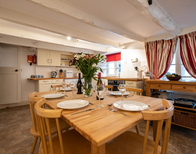 The open plan living/kitchen/dining room in St Samson, a quaint self catering holiday cottage in Port Isaac in North Cornwall.