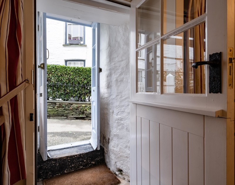 A small entrance porch welcomes you inside St Samson, a self catering holiday cottage yards from the harbour in Port Isaac in Cornwall.