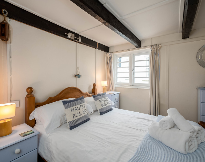 The pretty, nautical double bedroom in St Samson, a traditional fisherman's cottage available for holiday lettings near the harbour in Port Isaac, Cornwall.