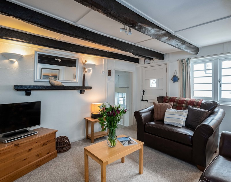 The first floor sitting room in traditional fisherman's cottage St Samson, a holiday rental yards from the harbour in Port Isaac in North Cornwall.