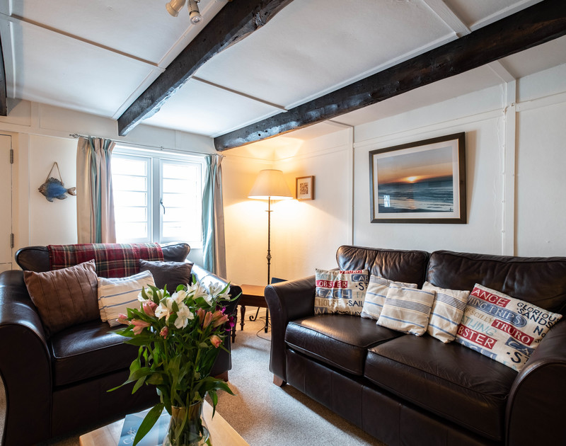 Exposed beams in the comfortable sitting room at St Samson, a gorgeous old fisherman's cottage for a self catering holiday in picturesque Port Isaac.
