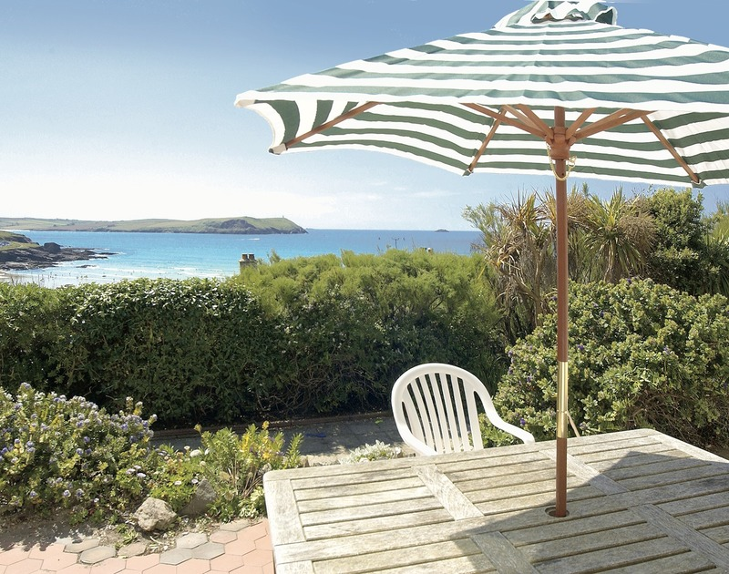 The stunning sea views and pretty terrace area at Pemberton, a spacious self catering holiday house in coastal, unspoilt New Polzeath, Cornwall.
