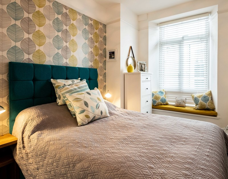 Contemporary chic and a sweet window seat in the double bedroom at The View, a trendy coastal apartment for up to four guests in Port Isaac.