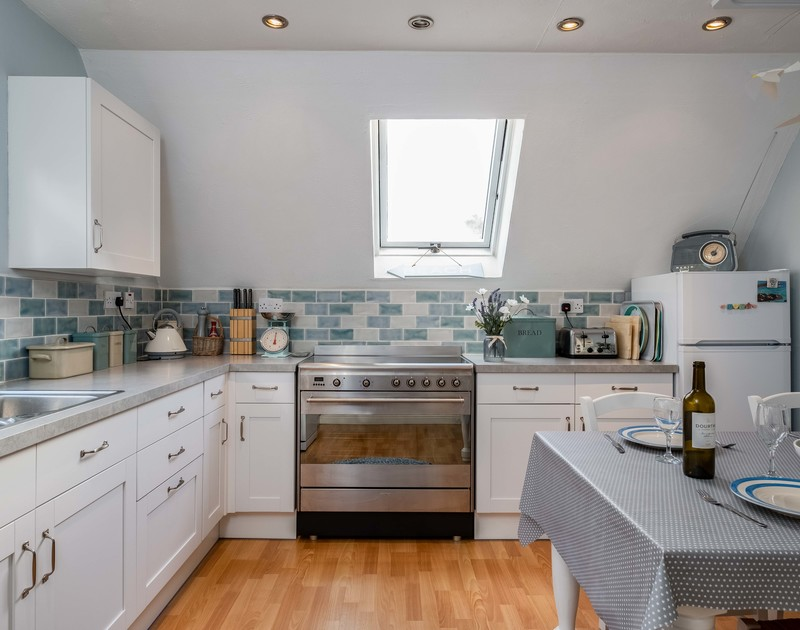 The skylight fills the kitchen at self catering holiday house Rocklings with natural Cornish light.
