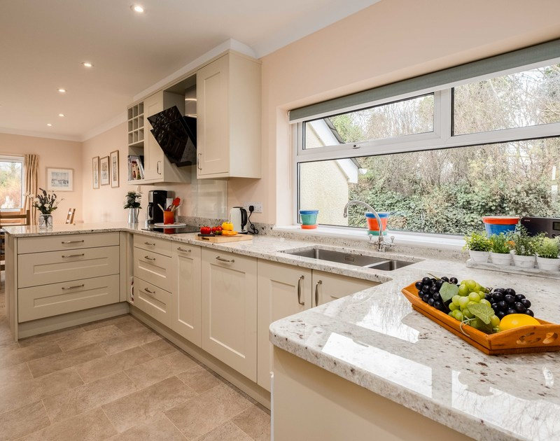 Plenty of natural Cornish light and worktop space in the kitchen at Tamarisk, a self catering holiday house to rent in Rock, North Cornwall.