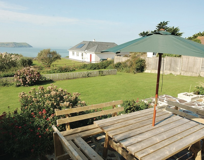 Stunning seaviews from the gently sloping lawned garden of Chy-An-Var, holiday house in New Polzeath, Cornwall