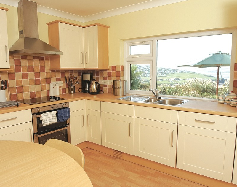 Attractive, light kitchen with gorgeous coastal views at Chy-An-Var, holiday house in Polzeath, Cornwall