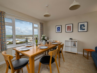 The dining room with amazing sea views at Windyhill self catering holiday home in Polzeath on the North Cornwall coast.