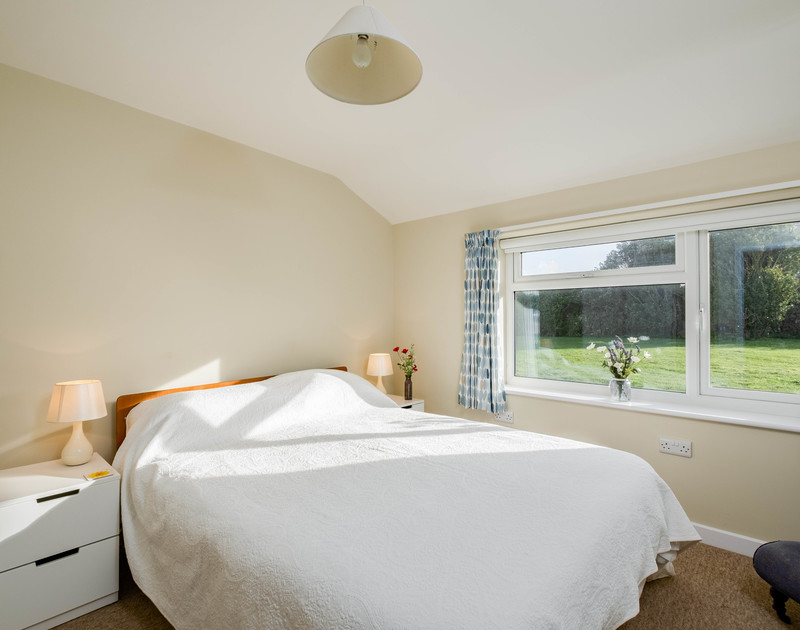 The king bedroom at Windyhill self catering holiday home at Polzeath, North Cornwall.