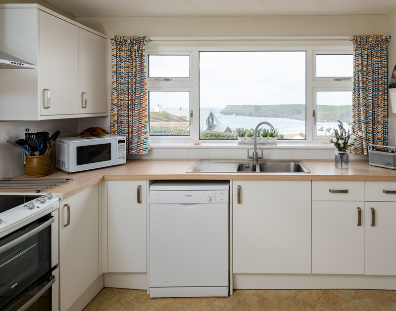 The well-equipped kitchen at Windyhill self catering holiday home in Polzeath, Cornwall.