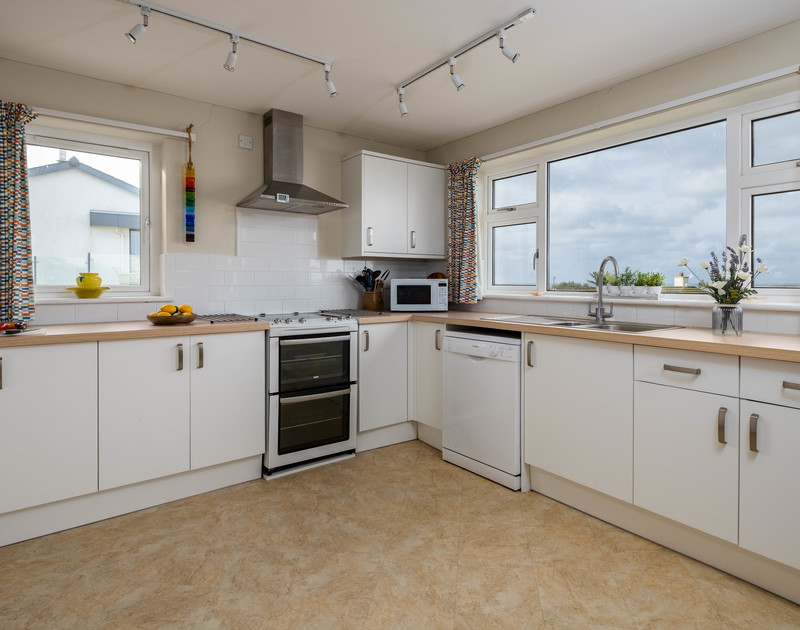 The well-equipped kitchen at Windyhill self catering holiday home in Polzeath, North Cornwall.