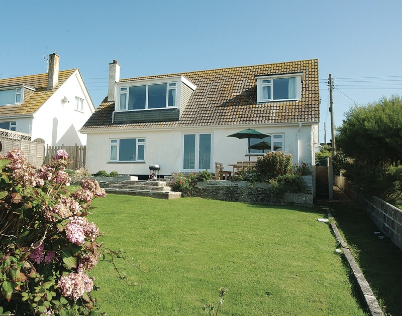 The sunny rear garden and exterior of Chy-An-Var, well-located holiday house in Polzeath, Cornwall
