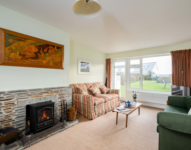 The cosy lounge with fire place at Windyhill self catering holiday home in Polzeath, North Cornwall.