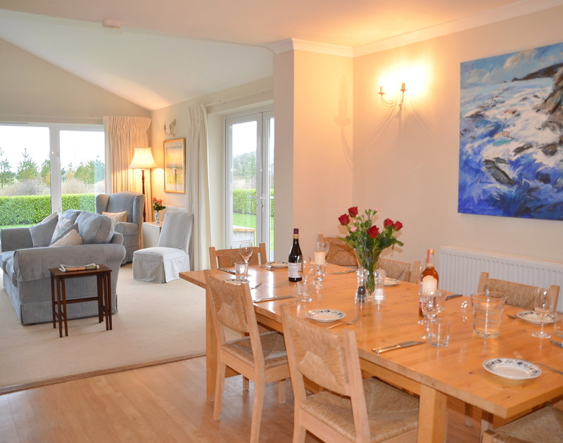 The open plan dining and living room at Trewin self catering holiday home in Rock.