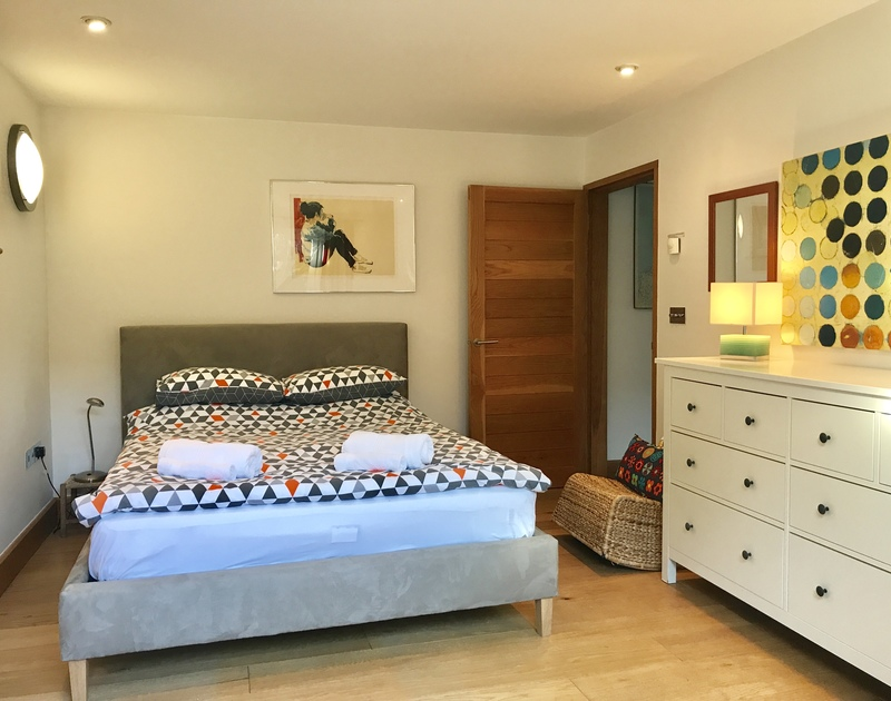 With access to the terrace, the lower ground floor bedroom with a double bed