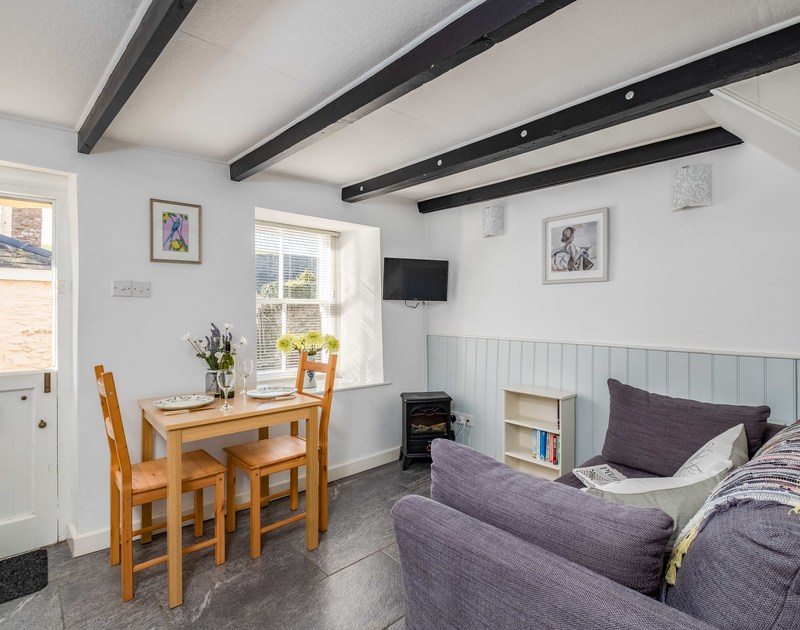 The cosy living room and dining room at Homestead self catering holiday home in Port Isaac.